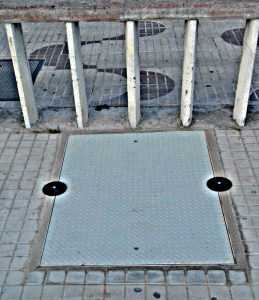 system to block manhole covers